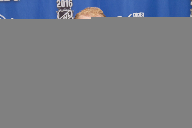 Chicago Blackhawks' Patrick Kane poses with the Art Ross Trophy, left, and the Hart Trophy after winning the awards at the NHL Awards show held at the Hard Rock Hotel and Casino in Las Vegas on We ...