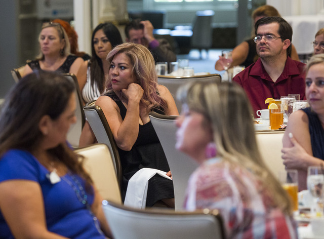 People listen while homeowner Rocio Rubio, not shown, speaks about how she almost lost her home during the 2016 Southern Nevada Housing Event for Realtors at the Four Seasons, 3960 Las Vegas Blvd. ...
