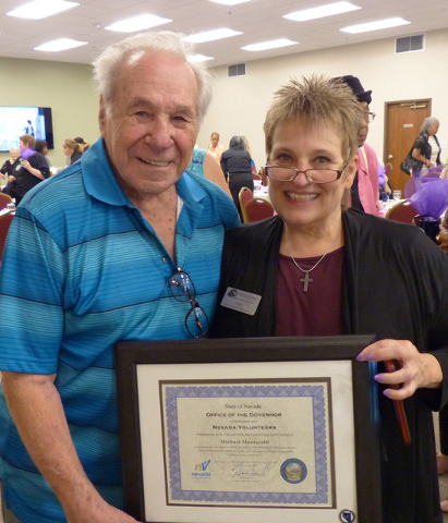 Honoree Michael Mazzarelli, 91, and program supervisor Cindy Egan smile during an award ceremony May 20, 2016, recognizing Mazzarelli and Elaine Slanhoff (not pictured) with the Governor's Volun ...