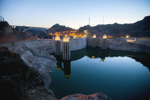 Lake Mead behind Hoover Dam reflects the sky at dusk on June 5. Since 2014, the U.S. Bureau of Reclamation has been closing the top of the dam to the general public at night. Jeff Scheid/Las Vegas ...