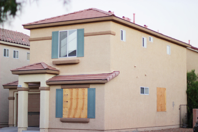 A house purchased new in 2005 now has  boarded up windows on the first floor located on Gold Nugget Drive in Las Vegas. It is in the foreclosure process, according to records from the county recor ...