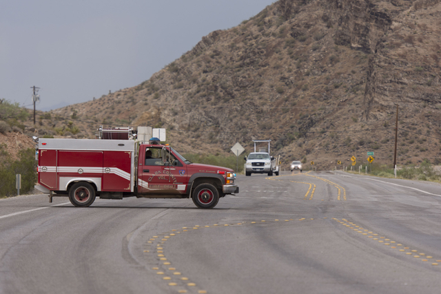 The Clark County Volunteer Fire Department turns aways traffic on state Route 159 just south of Bonnie Springs in Red Rock Canyon National Conservation Area due to a road washout Thursday, June 30 ...