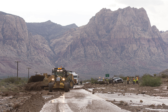 Crews on state Route 159 just south of Bonnie Springs in Red Rock Canyon National Conservation Area work to reopen the highway which was closed due to a washout Thursday, June 30, 2016. (Jason Ogu ...