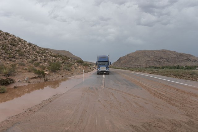 A big rig waits on state Route 159 just south of Bonnie Springs in Red Rock Canyon National Conservation Area as crews work to reopen a road washout Thursday, June 30, 2016. (Jason Ogulnik/Las Veg ...