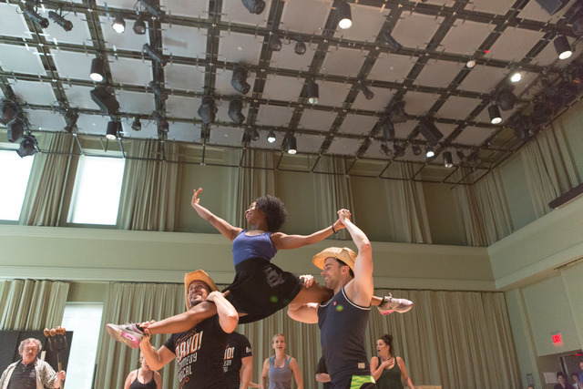 """Destinee Rea, as Shenequa, gets a lift from fellow """"Idaho!"""" cast members during a run-through of the musical comedy, which opens a 13-performance run Wednesday at The Smith Center. (Elizabeth Brum ..."""