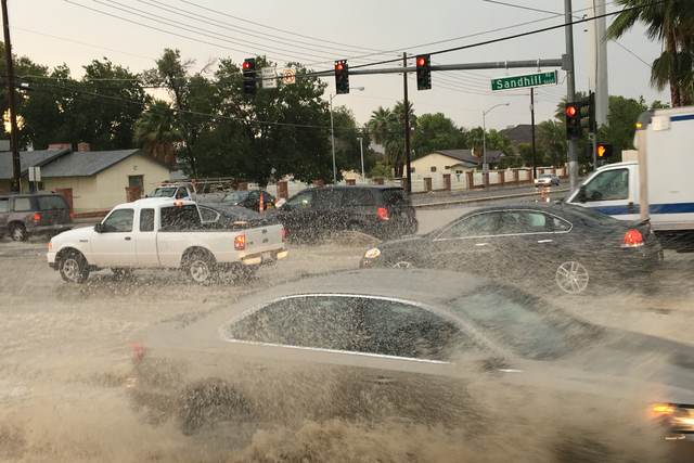 Flooded streets are seen at Sandhill Road and Russell Road in Las Vegas on June 30, 2016. (Bizuayehu Tesfaye/Las Vegas Review-Journal)