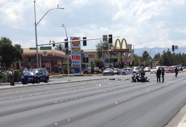 A motorcyclist died after being hit by a car that ran a red light at Charleston Boulevard and Buffalo Drive in Las Vegas on Saturday, June 11, 2016. (Greg Haas/Las Vegas Review-Journal Follow @RJg ...