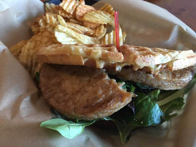 The vegan Guru Burger is seen at Tiabi Coffee & Waffle Bar, 3961 S. Maryland Parkway. It is made with sweet and savory guru sauce, tomato, spring mix and faux meat. Daiya mozzarella can be add ...
