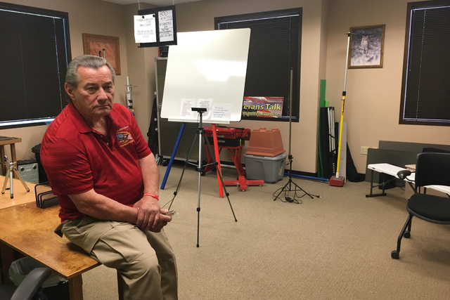 Jim Lytner, chief operating officer of the Veterans Transition Resource Center, 2550 Nature Park Drive, Suite 200, in North Las Vegas, sits on a table inside the center where he and his cohost RJ  ...