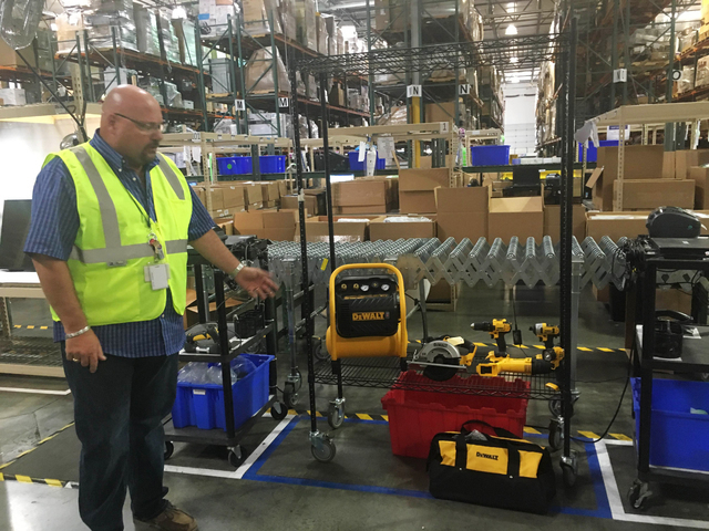 Alan Noble, general manger of operations for Liquidity Services, gives a tour of the warehouse at 3010 E. Alexander Road, Suite 1001 in North Las Vegas June 15, 2016. The company sells everything  ...