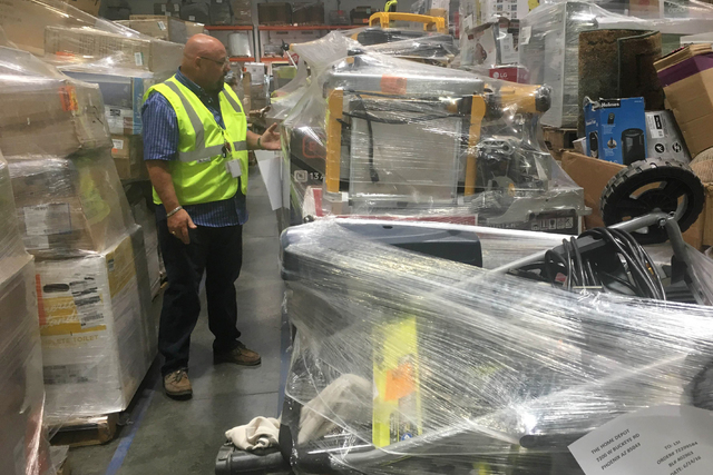 Alan Noble, general manger of operations for Liquidity Services, gives a tour of the warehouse at 3010 E. Alexander Road, Suite 1001 in North Las Vegas June 15, 2016. Sandy Lopez/View