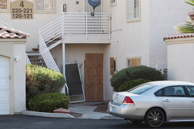 A car sits outside a boarded-up unit in Torrey Pines condominiums in Las Vegas on Thursday, June 30, 2016, where police say part of a quadruple murder-suicide took place Wednesday night. Brett Le  ...