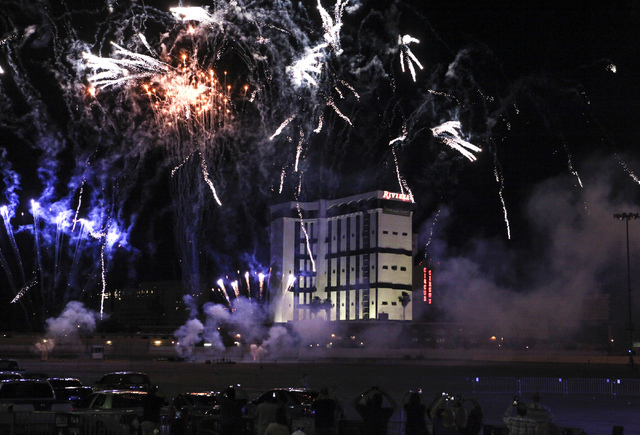 Fireworks go off seconds before the implosion of the Monaco tower at the Riviera hotel on the Las Vegas Strip on Tuesday. The 24-story tower is the first of the two to be imploded at the site to m ...