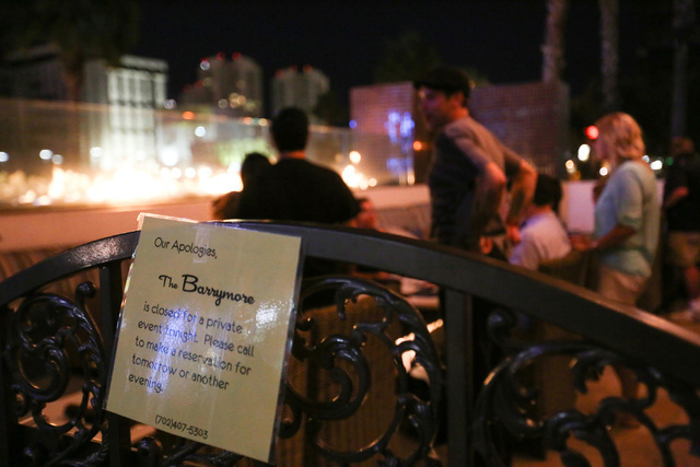 A sign hangs on an entrance to the Barrymore during a watch party for the implosion of a Riviera hotel tower, seen top left, at the Barrymore in Las Vegas on Tuesday, June 14, 2016. Brett Le Blanc ...
