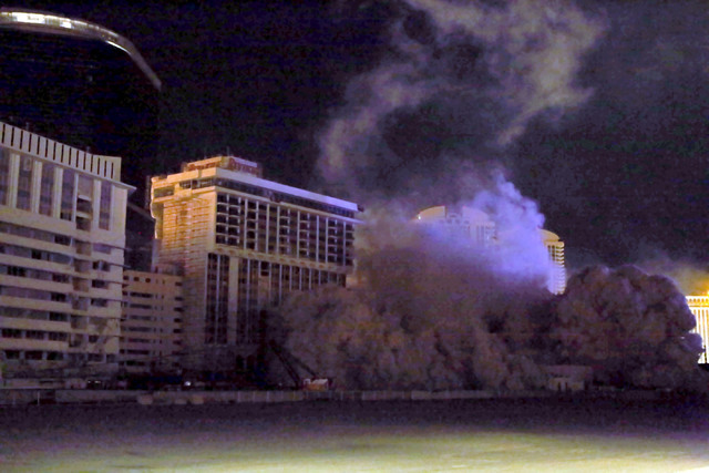 4 of 4-The Monaco tower at the shuttered Riviera comes crashing down in a controlled implosion on Tuesday, June 14, 2016.  Jeff Scheid/Las Vegas Review-Journal Follow @jlscheid