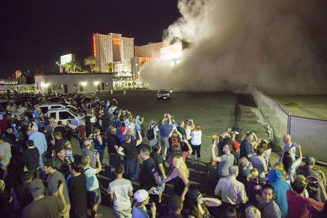 A cloud of dust from the imploded Monaco tower moves toward people at the Peppermill parking lot on Tuesday, June 14, 2016.  Jeff Scheid/Las Vegas Review-Journal Follow @jlscheid
