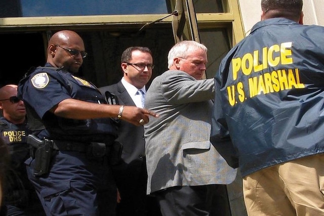Jared Fogle is led from federal court in Indianapolis, Indiana August 19, 2015. (Susan Guyett/Reuters)