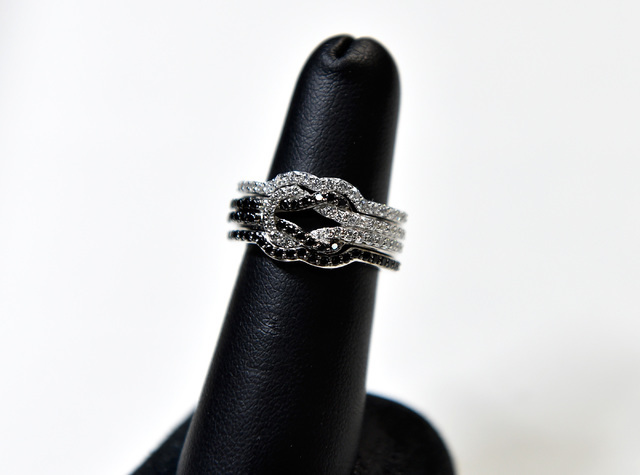 """A set of wedding rings from the """"Tie The Knot"""" collection are seen at the Rony Tennenbaum booth at the JCK Las Vegas jewelry industry show at the Mandalay Bay Convention Center F ..."""