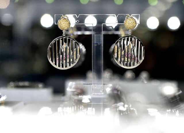 """A set of earring from Vicky Lew's """"Flight"""" collection is seen at her booth at the JCK Las Vegas jewelry industry show at the Mandalay Bay Convention Center Friday, June 3, 2016,  ..."""