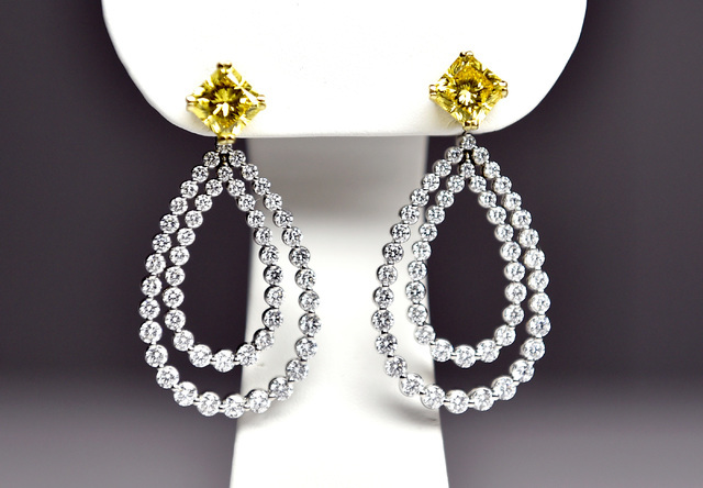 A set of earrings created from grown diamonds are displayed at the Pure Grown Diamond booth at the JCK Las Vegas jewelry industry show at the Mandalay Bay Convention Center Friday, June 3, 2016, i ...