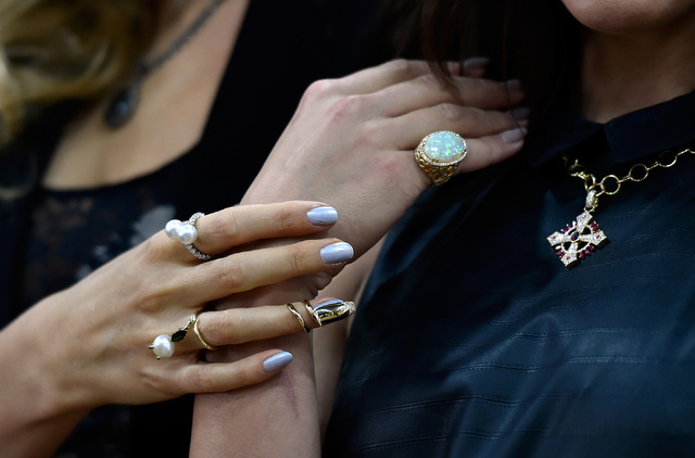 Models display pieces of jewelry during a panel discussion of new trends at the JCK Las Vegas jewelry industry show at the Mandalay Bay Convention Center Friday, June 3, 2016, in Las Vegas. David  ...