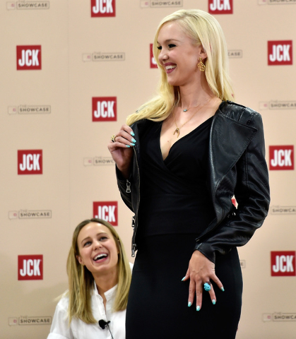 Fashion editor Shannon Adducci, left, looks up to model Kristina Schiavi during a panel discussion at the JCK Las Vegas jewelry industry show at the Mandalay Bay Convention Center Friday, June 3,  ...