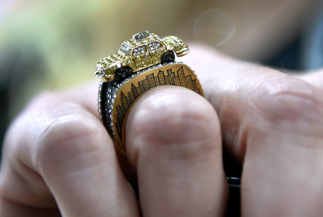 A model displays a ring designed as a taxi cab during a panel discussion at the JCK Las Vegas jewelry industry show at the Mandalay Bay Convention Center Friday, June 3, 2016, in Las Vegas. David  ...