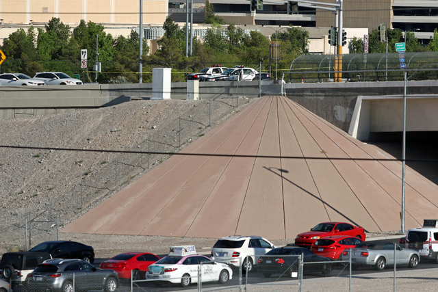 A congested Dean Martin Drive is shown below where Las Vegas police are working at eastbound Flamingo Road above I-15 Sunday, June 19, 2016, in Las Vegas. Authorities said a man fleeing a traffic  ...