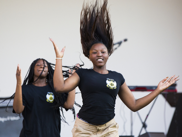 Khymira Doss performs with the Las Vegas High Steppers during the Juneteenth Festival, marking the day in 1865 when Texas slaves finally learned about their freedom, Sunday, June 19, 2016 at Loren ...