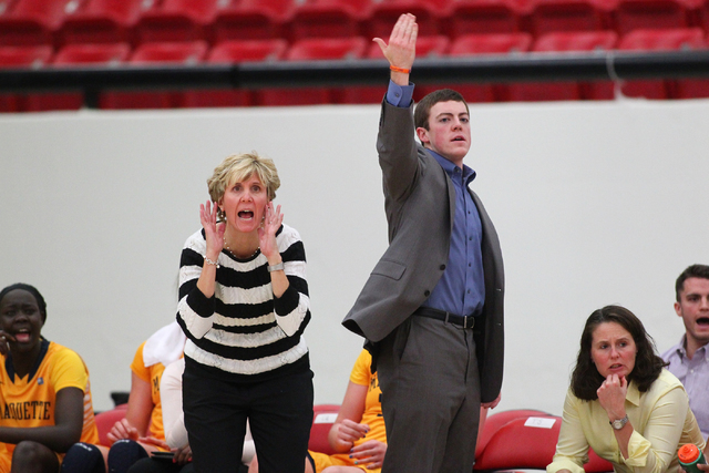 Marquette assistant coach Tyler Summitt, son of NCAA women's basketball coaching legend Pat Summitt, motions to players as head coach Terri Mitchell shouts to the team as the Golden Eagles take on ...