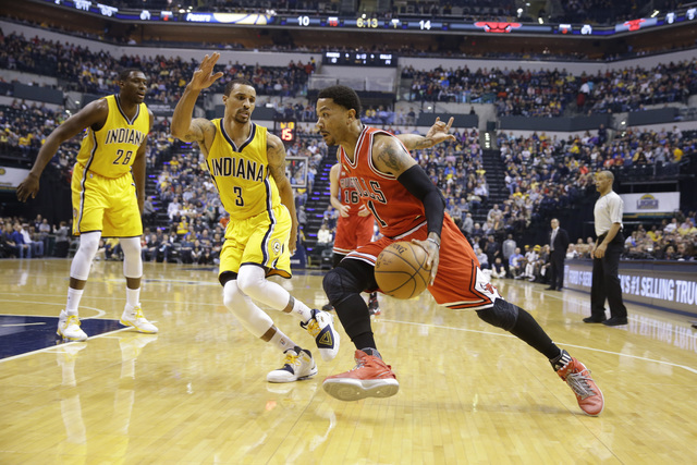 In this March 29, 2016 file photo, Chicago Bulls guard Derrick Rose (1) drives on Indiana Pacers guard George Hill (3) during the first half of an NBA basketball game in Indianapolis. (Michael Con ...