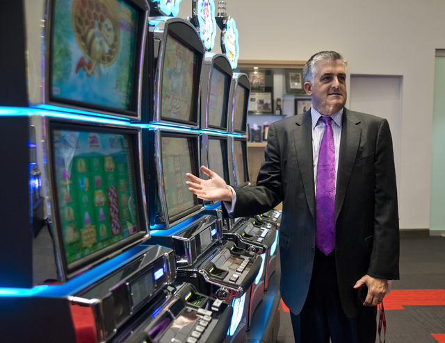 Chief Administrative Officer Thomas Jingoli shows off some slot machines in the showroom inside the headquarters of Konami Gaming in Las Vegas on Tuesday, May 17, 2016. Daniel Clark/Las Vegas Revi ...