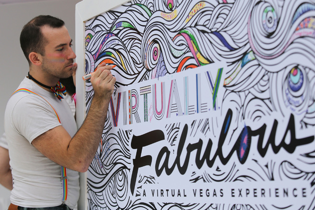 Jeff Della Serra, a 24-year-old from Los Angeles, colors in part of a coloring wall at the Las Vegas virtual reality booth at the Los Angeles Pride Festival on Saturday, June 11, 2016. Brett Le Bl ...