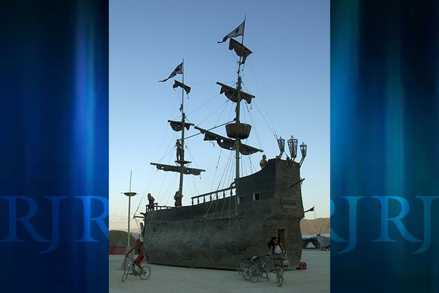 A man works on the mast of La Contessa on the Playa of the Black Rock Desert at the Burning Man Festival in Northern Nevada in 2003. (Andy Barron/AP)