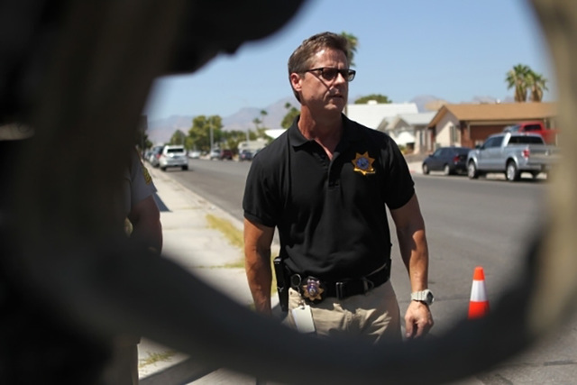 Las Vegas police Sgt. John Sheahan discusses an officer-involved shooting near the intersection of Alta Drive and Antelope Way on Sunday morning. (Erik Verduzco/Las Vegas Review-Journal)