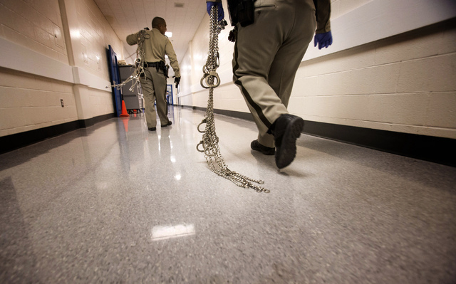 Officers walk down a hall in the Clark County Detention Center at 330 S. Casino Center Boulevard on Thursday, Nov. 7, 2013. (Jeff Scheid/Las Vegas Review-Journal)