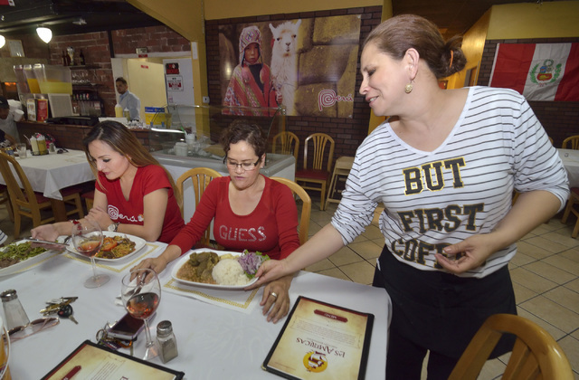 Janeth Barrezueto, right, serves Sally Zuniga, left, and her mother Maria at Las Americas at 2319 S. Eastern Ave. in Las Vegas Las Vegas June 17, 2016. Bill Hughes/Las Vegas Review-Journal