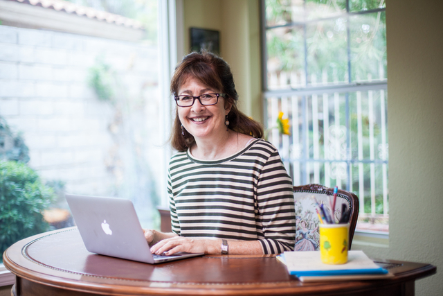 "Author and College of Southern Nevada Professor Laura McBride poses for a photo at her home in Henderson on Tuesday, July 15, 2014. McBride recently published her debut novel, ""We Are Cal ..."
