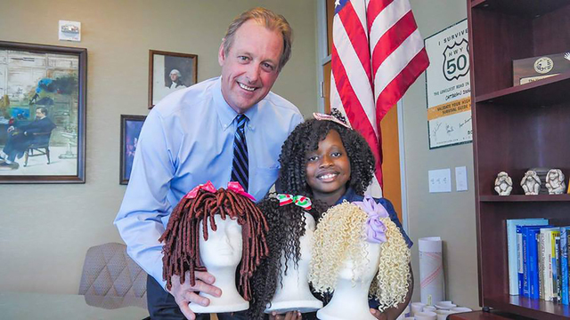 North Las Vegas Mayor John Lee and Lauren LaRay smile over Lauren's handmade wigs after Lee gave her a proclamation and announced May 4, 2016, as officially Lauren LaRay Collins Day. Special to View