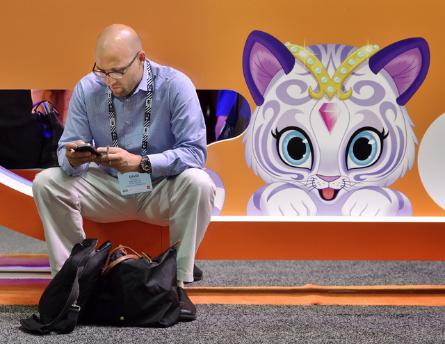 David Contract, senior director of marketing for Nuk, a baby products company, catches up with emails outside of the Nickelodeon booth during the Licensing Expo at the Mandalay Bay Convention Cent ...