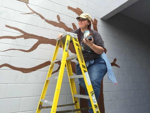 Las Vegas artist Celestia Ward ascends a ladder May 20, 2016, at Leavitt Middle School, 4701 Quadrel St., as she paints the artwork developed from students' input. The school held a contest to i ...