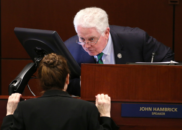 Nevada Assembly Speaker John Hambrick, R-Las Vegas, talks with Chief Clerk Susan Furlong on the Assembly floor at the Legislative Building in Carson City, Nev., on Friday, Feb. 13, 2015. A notice  ...