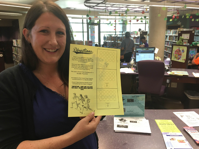 North Las Vegas spokeswoman Delen Goldberg holds a summer reading log book for participants of the North Las Vegas Library District's Summer Reading Program at the Aliante Library, 2400 Deer Spr ...