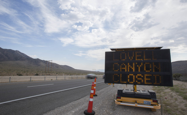A sign warning passers-by about the wildfire is seen along state Route 160 near Lovell Canyon Road on Monday, June 27, 2016. (Richard Brian/Las Vegas Review-Journal)