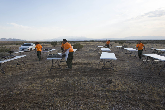 Prison inmates assemble tables and chairs in preparation for arriving fire crews fighting the Lovell wildfire near state Route 160 and Lovell Canyon Road on Monday, June 27, 2016. (Richard Brian/L ...