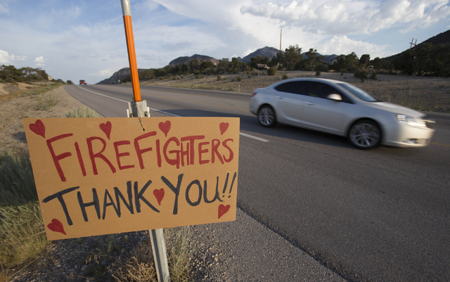 A placard supporting firefighters is seen along State Route 160 near Benedict Drive on Monday, June 27, 2016. (Richard Brian/Las Vegas Review-Journal)