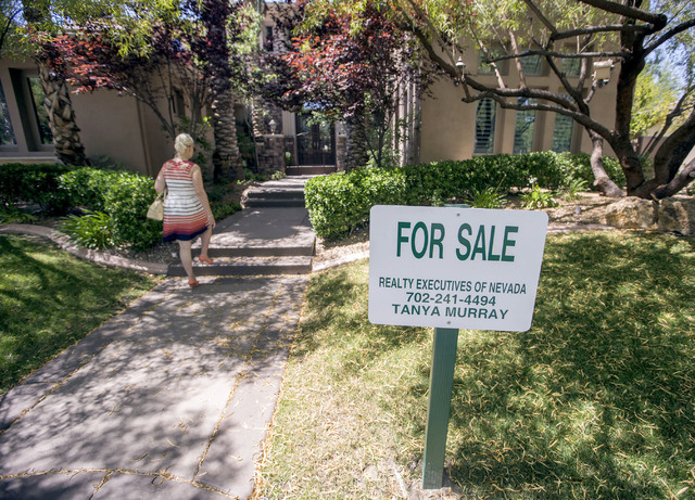 Fafie Moore, broker/owner for Realty Executives, walks to a home her company listed at 2261 Candlestick Avenue in Henderson on Monday, May, 31, 2016. The four-bedroom, 8,406-square-foot home is on ...