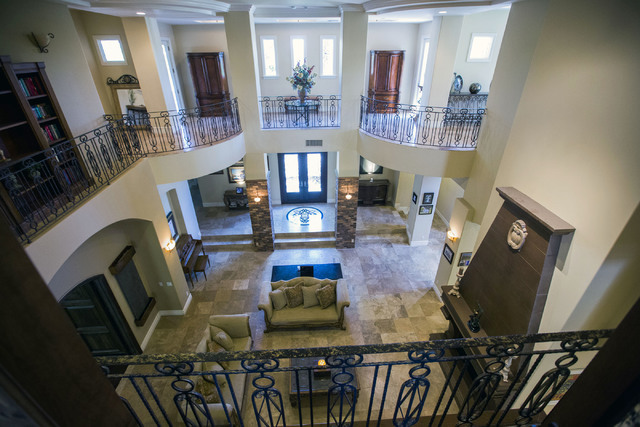 The living room from a second floor overlook at 2261 Candlestick Avenue in Henderson is seen on Monday, May, 31, 2016. The four-bedroom, 8,406-square-foot home is on the market for $1,675,000. (Je ...