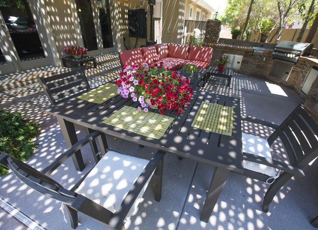 The outdoor dining area at 2261 Candlestick Avenue in Henderson is seen on Monday, May, 31, 2016. The four-bedroom, 8,406-square-foot home is on the market for $1,675,000. (Jeff Scheid/Las Vegas R ...