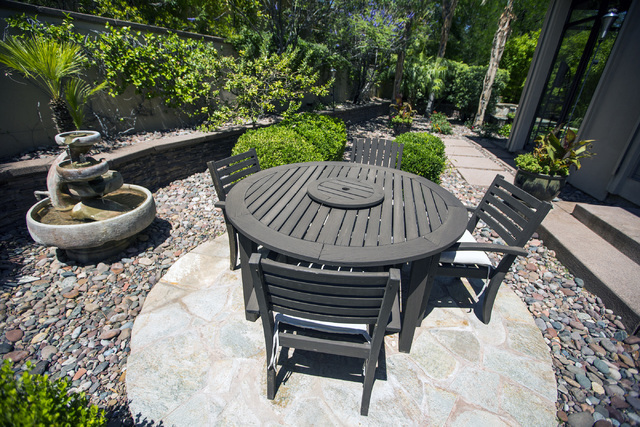 The outdoor sitting area at 2261 Candlestick Avenue in Henderson is seen on Monday, May, 31, 2016. The four-bedroom, 8,406-square-foot home is on the market for $1,675,000. (Jeff Scheid/Las Vegas  ...